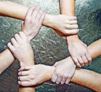Web Marketing - Many hands clasping image